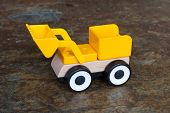 stock photo of dozer  - Simple wheel dozer toy plastic and wood - JPG