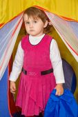 Little Girl Looks Out Of Tourist Tent poster