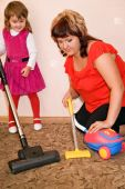 pic of child abuse  - Little Girl and woman vacuum a carpet - JPG