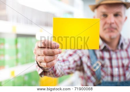Farmer With Sign At Supermarket