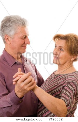 Old Couple Dancing On A White Background