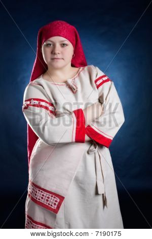 Russian funny woman posing in national clothes
