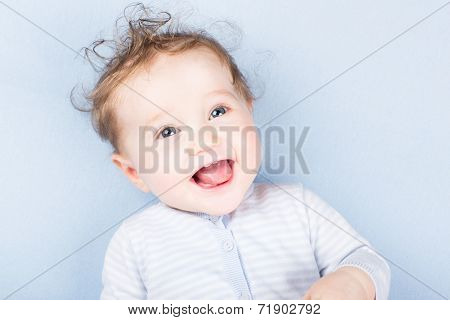 Beautiful Laughing Baby On A Blue Blanket