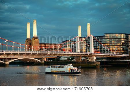 LONDON, UK - SEP 27: Battersea Power Station and bridge in Thames River on September 27, 2013 in London, UK. London is the world's most visited city and the capital of UK.