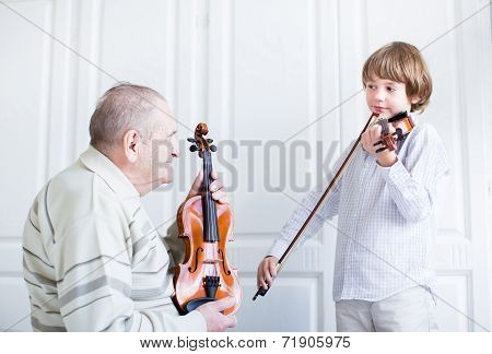 Great Grandfather Listening To A Child Playing Violin
