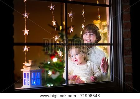 Kids At Window On Christmas Eve