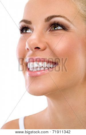 Beautiful smile of young woman with great healthy white teeth, isolated over white background