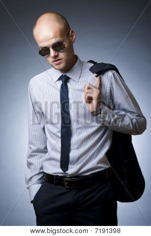 Young Businessman Looking Down To Everybody