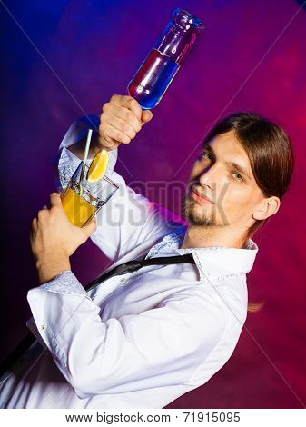 Young Man Bartender Pouring A Drink