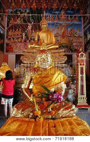 Worship Buddha Statue in the Chapel