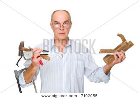 Man With Tools In His Hands