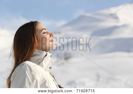 Explorer Woman Breathing Fresh Air In Winter In A Snowy Mountain