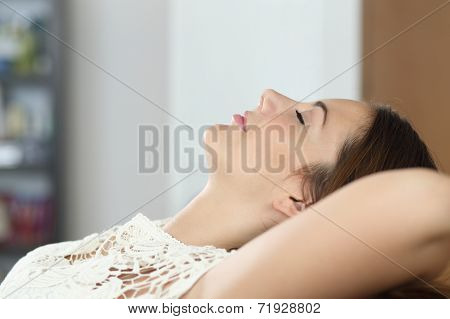Woman Relaxing And Sleeping On The Couch At Home