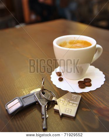Cup Of Coffee On The Desk  And  Keys