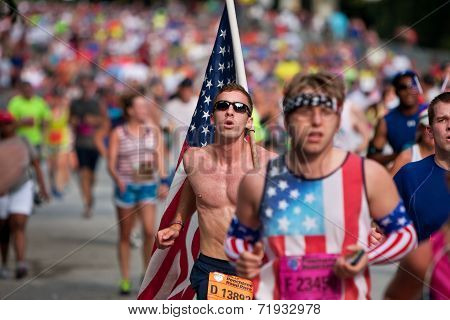 Young Man Carries Large American Flag In Atlanta 10K Race