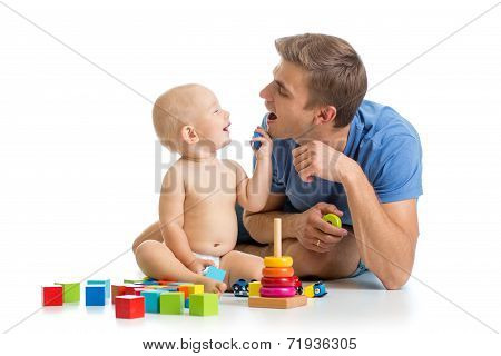 Happy Baby Boy And Dad Play Together