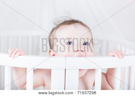 Funny Little Baby Biting On A Crib