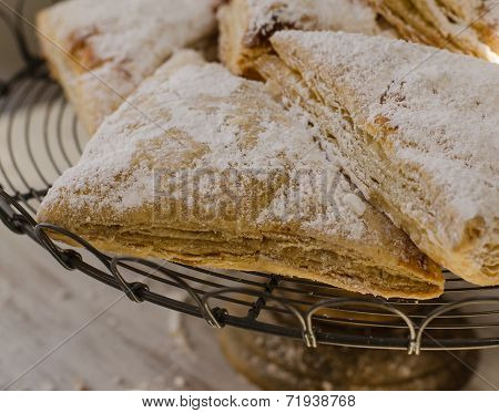 Flakey pastries on rack