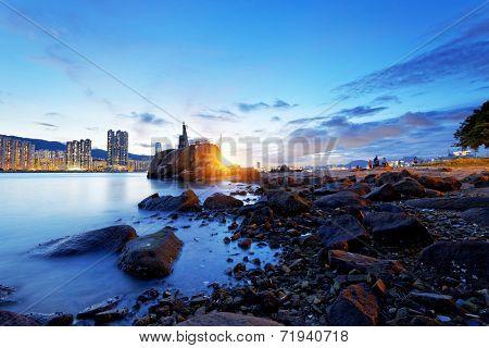 Hong Kong water bay and lighthouse at sunset,Yau Tong Lei Yue Mun