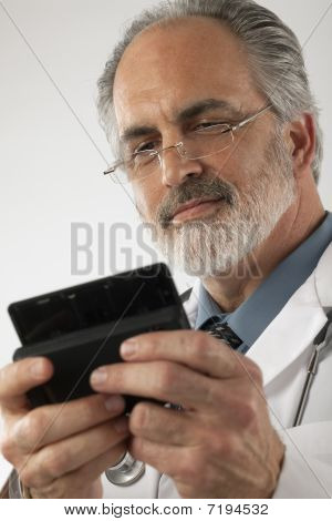 Doctor Texting On A Cell Phone