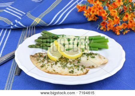 Healthy, Fresh Tilapia Fillets With Asparagus And Hollandaise Sauce.