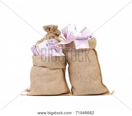 Two full bags with euro banknotes.