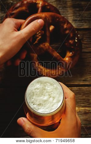 Man Holding Beer And Pretzel