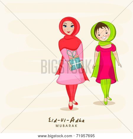 Young Muslim ladies with gift box on beige background for Muslim community festival Eid-Ul-Adha Mubarak celebrations.