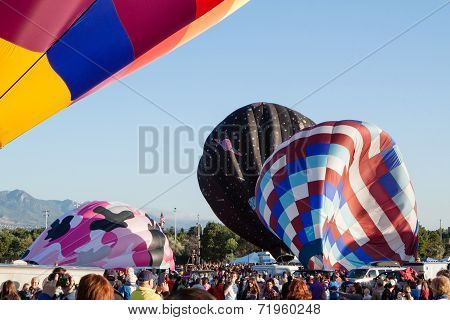 Wind gust and partially inflated balloons