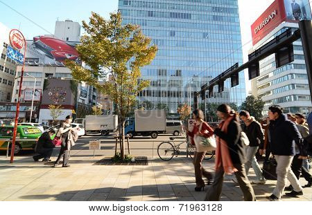 Tokyo, Japan - November 24, 2013: People Walk By Store Building On Omotesando Street