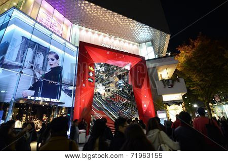 Tokyo, Japan - November 24, 2013: People Shopping Around Retail Shops On Omotesando Street At Night