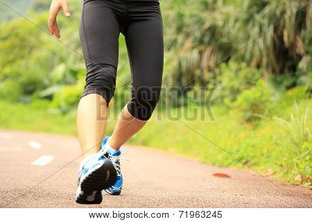 woman runner running on trail