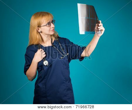 Female doctor looking at the x-ray picture.