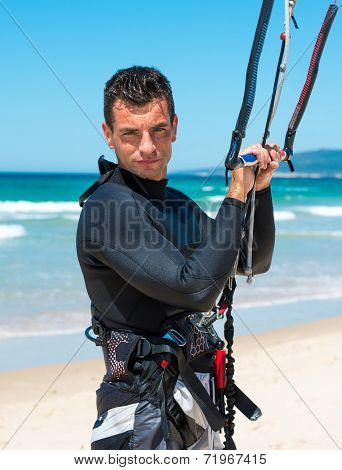 handsome athlete going to kite surfing training