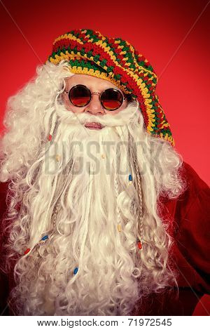 Portrait of a casual Santa Claus hippie over festive red background.