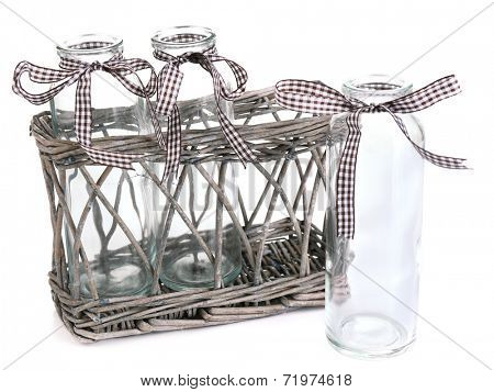Empty bottles in basket isolated on white