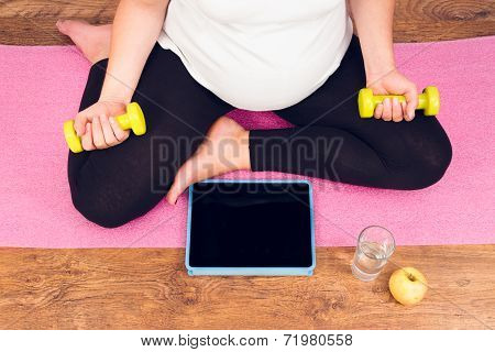 Active Pregnant Woman With Dumbbells Exercising With Video Course