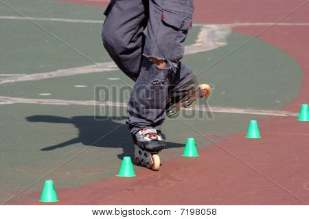 Rollerblade skater practicing tight slalom
