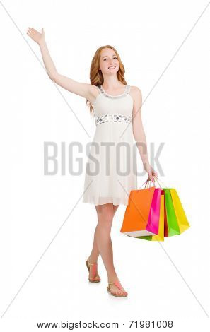 Woman after shopping spree on white