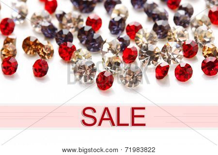 Concept of discount. Beautiful gem stones