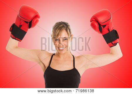 Young beautiful female boxer portrait