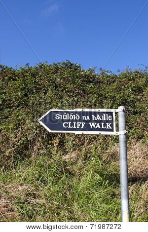 Cliff Walk Sign Beside The Cliffs