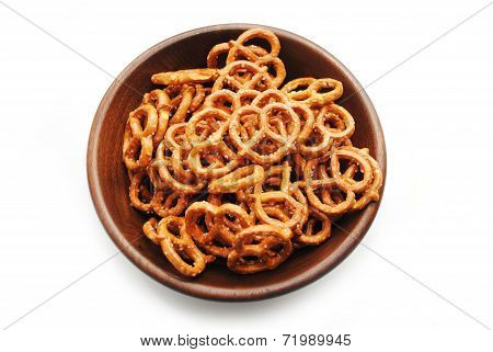 Pretzels In A Round Wooden Bowl Over White