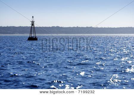 Beacon Floating On Blue Ocean As Guide Help