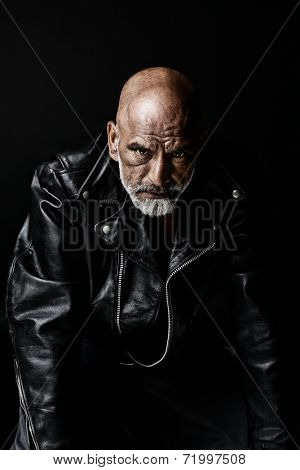 Strong Image of a very Tough Man on Black