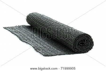 A roll of black non-slip rubber matting