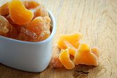 image of home remedy  - Closeup candied crystallized ginger candy pieces in white bowl - JPG