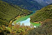 stock photo of polution  - Greek landscape lake on mountains and few houses - JPG