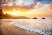 stock photo of karnataka  - Om beach at orange sunrise sky in Gokarna Karnataka India - JPG