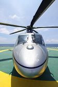 stock photo of offshore  - helicopter parking landing on offshore platform - JPG